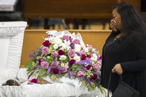 (Marie De Jesus/Houston Chronicle via AP). A mourner approaches the casket of Jazmine Barnes during a viewing ceremony before the memorial services on Tuesday, Jan. 8, 2019 at the Community of Faith Church in Houston.  Barnes was fatally shot, Dec. 30,...