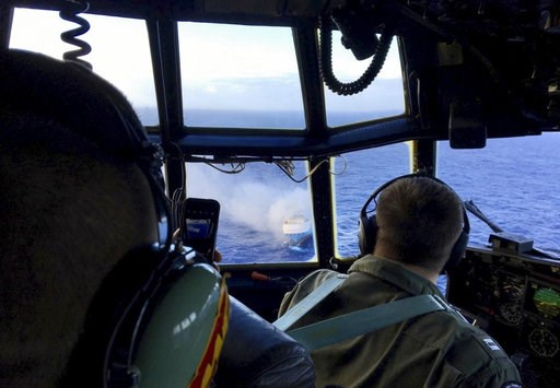 (U.S. Coast Guard via AP,File). FILE - In this Dec. 31, 2018 file photo provided by the U.S. Coast Guard, a Coast Guard HC-130 Hercules aircrew flies over the 650-foot Sincerity Ace on fire 1,800 nautical miles northwest of Oahu in the Pacific Ocean. A...