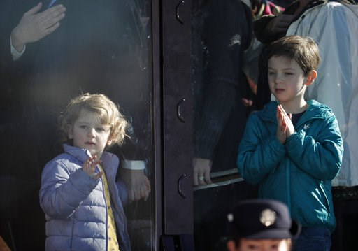 (AP Photo/David Zalubowski, Pool). The children of Colorado Governor Jared Polis and his partner Marlon Reis, 4-year-old Cora, left, and 7-year-old Caspian, look on during the playing of the National Anthem at the inauguration ceremony Tuesday, Jan. 8,...