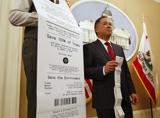 (AP Photo/Rich Pedroncelli). Assemblyman Phil Ting, D-San Francisco, displays a long paper receipt as he discusses his bill to require businesses to offer electronic receipts, Tuesday, Jan. 8, 2019, in Sacramento, Calif. Under the legislation customers...