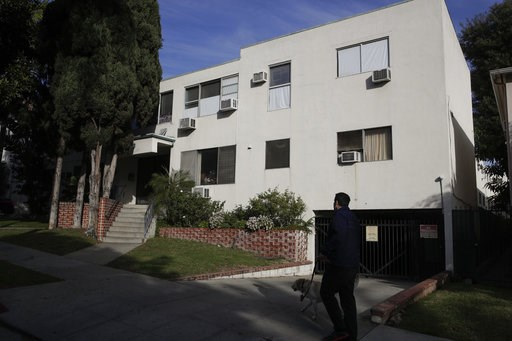 (AP Photo/Jae C. Hong). A man walks his dog past an apartment building Tuesday, Jan. 8, 2019 where an unidentified man died Monday in the apartment of Democratic Party donor Ed Buck, in West Hollywood, Calif. Los Angeles County sheriff's detectives hav...
