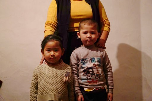 (AP Photo/ Dake Kang). In this Dec. 8, 2018, photo, a 23-year-old Kazakh citizen who asked to be identified by her nickname, Guli, to protect her family from retribution, stands with her children at their home in a village near Almaty, Kazakhstan. The ...