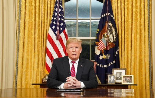 (Carlos Barria/Pool Photo via AP). President Donald Trump speaks from the Oval Office of the White House as he gives a prime-time address about border security Tuesday, Jan. 8, 2018, in Washington.