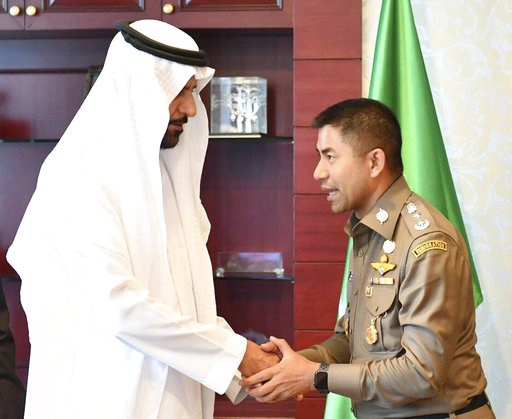 (The Immigration Police via AP). In this photo released by the Thailand Immigration Police,  Saudi Arabia's Charge Affaires Abdalelah Mohammed A. Alsheaiby, left, shakes hands with Chief of Immigration Police Maj. Gen. Surachate Hakparn at the Saudi Ar...
