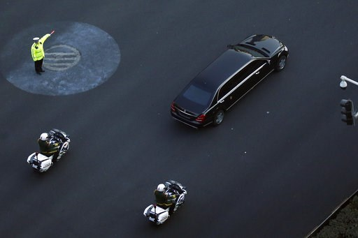 (AP Photo/Andy Wong). A traffic policeman shows direction to a Mercedes limousine with a golden emblem, similar to one North Korean leader Kim Jong Un has used previously, is escorted by motorcades traveling past Chang'an Avenue in Beijing, Wednesday, ...