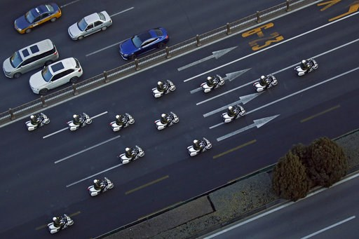(AP Photo/Andy Wong). Chinese paramilitary policemen on motorcycles escort a motorcade believed to be carrying North Korean leader Kim Jong Un traveling past Chang'an Avenue in Beijing, Wednesday, Jan. 9, 2019. North Korean state media reported Tuesday...