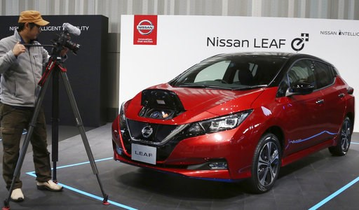 (AP Photo/Koji Sasahara). Nissan LEAF e+ is on display at the global headquarters of Nissan Motor Co., Ltd. in Yokohama Wednesday, Jan. 9, 2019.  Nissan is showing the beefed up version of its hit Leaf electric car as the Japanese automaker seeks to di...