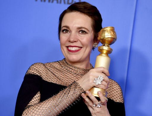 "(Photo by Jordan Strauss/Invision/AP). Olivia Colman poses in the press room with the award for best performance by an actress in a motion picture, musical or comedy for ""The Favourite"" at the 76th annual Golden Globe Awards at the Beverly Hilton Hotel..."
