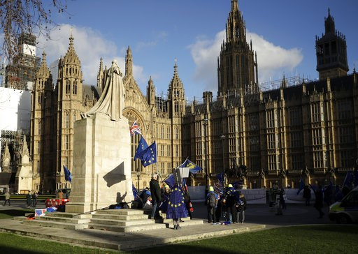 (AP Photo/Matt Dunham). Pro-Europe demonstrators hold banners and flags outside the Houses of Parliament in London, Tuesday Jan. 8, 2019. The British government on Tuesday ruled out seeking an extension to the two-year period taking the country out of ...