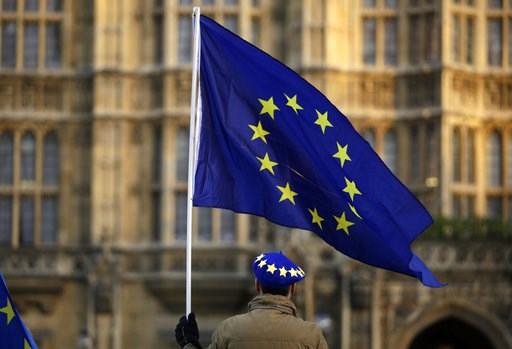 (AP Photo/Matt Dunham). A pro-Europe demonstrator holds a flag outside the Houses of Parliament in London, Tuesday Jan. 8, 2019. The British government on Tuesday ruled out seeking an extension to the two-year period taking the country out of the Europ...