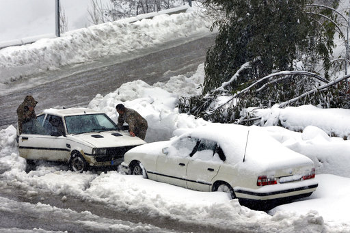(AP Photo/Bilal Hussein). Lebanese soldiers try to get their car running after it was stuck in snow, in the village of Hammana village, Mount Lebanon, Wednesday, Jan. 9, 2019. A storm packing snow and rain that has battered Lebanon for five days has le...