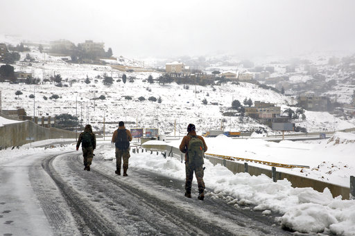 (AP Photo/Bilal Hussein). Lebanese soldiers walk on an icy road as they return to their base camp in the village of Sawfar, Mount Lebanon, Wednesday, Jan. 9, 2019. A storm packing snow and rain that has battered Lebanon for five days has left an 8-year...