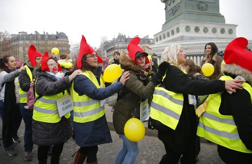 (AP Photo//Michel Euler). Women donning red bonnets , that symbolizes the French Revolution and wearing yellow vests march during a protest in Paris, Sunday, Jan. 6, 2019. Several hundred women wearing yellow vests march during a rally in Paris to give...