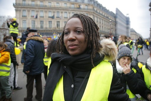 (AP Photo//Michel Euler). Priscillia Ludosky one of the leader of the yellow vests movement march during a protest in Paris, Sunday, Jan. 6, 2019. Several hundred women wearing yellow vests march during a rally in Paris to give a different image to the...