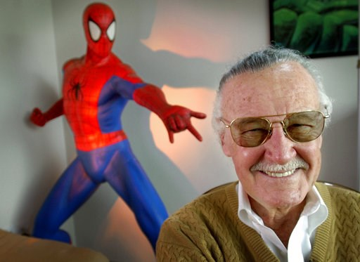 "(AP Photo/Reed Saxon, File). This April 16, 2002 file photo shows Stan Lee, creator of comic-book franchises such as ""Spider-Man,"" ""The Incredible Hulk"" and ""X-Men,"" posing near a Spider-Man figure in his Santa Monica, Calif., office. Friends, fans and..."