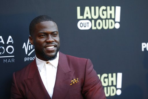 "(Photo by Danny Moloshok/Invision/AP, File). FILE - In this Aug. 3, 2017 file photo, Kevin Hart poses at Kevin Hart's ""Laugh Out Loud"" new streaming video network launch event at the Goldstein Residence in Beverly Hills, Calif.  Prodded by Ellen DeGene..."