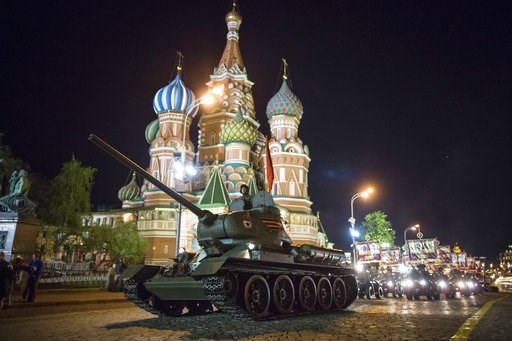 (AP Photo/Alexander Zemlianichenko, File). FILE - In this Thursday, May 3, 2018 filer, a World War II era Soviet tanks T-34 makes its way through the Red Square with the St. Basil's Cathedral in background, during a rehearsal for the Victory Day milita...
