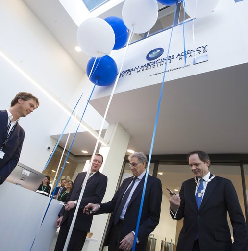 (AP Photo/Peter Dejong). In a sign of the looming Brexit, Italy's Guido Rasi, director of the European Medicines Agency, second right, and Dutch Health Minster Bruno Bruins, second left, perform the official opening of the agency's temporary headquarte...