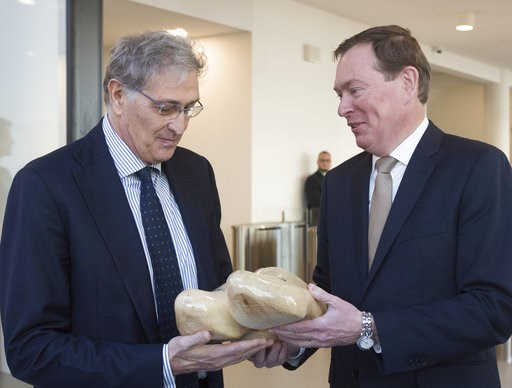 (AP Photo/Peter Dejong). In a sign of the looming Brexit, Italy's Guido Rasi, director of the European Medicines Agency, left, gets a pair of wooden shoes from Dutch Health Minster Bruno Bruins during the official opening of the agency's temporary head...