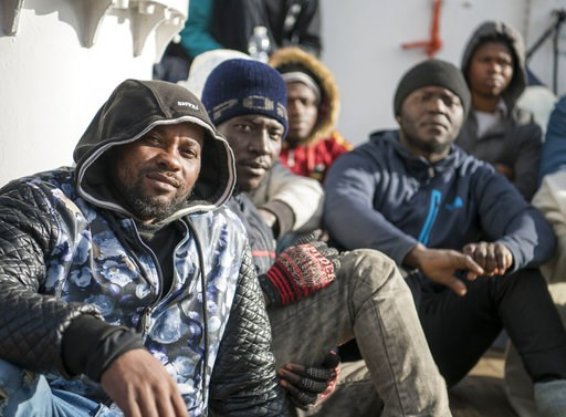 (AP Photo/Rene Rossignaud). Some of the 17 people rescued in the Mediterranean Sea sit aboard the German rescue ship Sea-Eye afloat off Malta, Tuesday, Jan. 8, 2019. Two German nonprofit groups appealed to European Union countries Tuesday to take in 49...