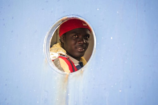 (AP Photo/Rene Rossignaud). A man smiles from aboard the Sea-Eye ship, in the Mediterranean Sea, Tuesday, Jan. 8, 2018. Two German nonprofit groups are appealing to European Union countries to take in 49 migrants whose health is deteriorating while the...