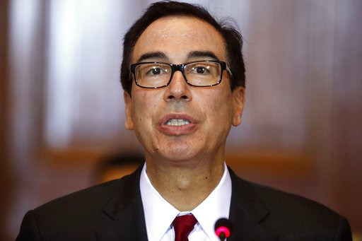 (AP Photo/Jacquelyn Martin, File). FILE- In this Oct. 16, 2018, file photo Treasury Secretary Steven Mnuchin leads a meeting of the Financial Stability Oversight Council at the Treasury Department in Washington. The heads of seven House committees are ...