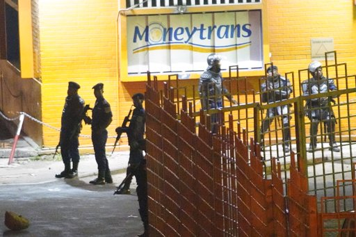 (AP Photo/Jerome Delay). Congolese riot police take position around the electoral commission building at night in Kinshasa, Congo, Tuesday Jan. 8, 2019. As Congo anxiously awaits the outcome of the presidential election, many in the capital say they ar...