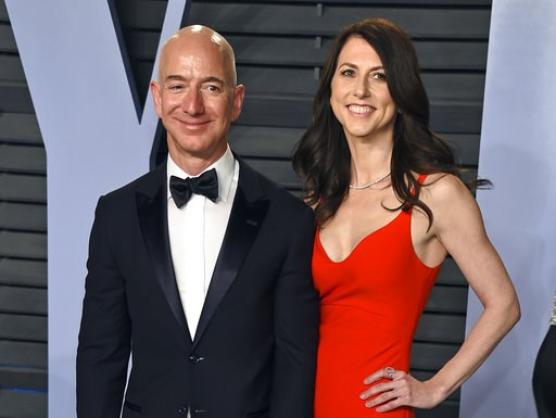 (Photo by Evan Agostini/Invision/AP, File). FILE - In this March 4, 2018 file photo, Jeff Bezos and wife MacKenzie Bezos arrive at the Vanity Fair Oscar Party in Beverly Hills, Calif.   Bezos says he and his wife, MacKenzie, have decided to divorce aft...
