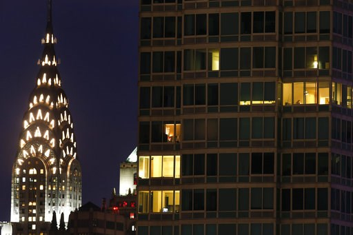 (AP Photo/Julie Jacobson, File). FILE - This May 14, 2015 file photo, shows the top of New York's iconic Chrysler Building, left, in a night view of Manhattan. The owners of the Art Deco skyscraper are putting it on the market. The Abu Dhabi Investment...