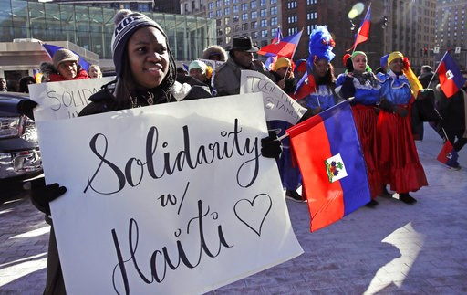 (AP Photo/Charles Krupa, File). FILE - In this Jan. 26, 2018 file photo, Haitian activists and immigrants protest on City Hall Plaza in Boston.   A trial in New York over the Trump administration's move to cut off permission for thousands of Haitians t...