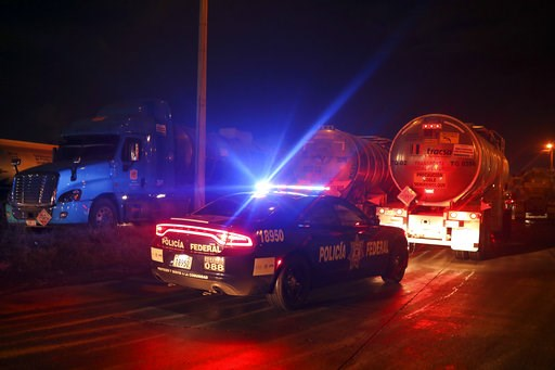 (AP Photo/Felix Marquez). Federal police escort loaded fuel tankers carrying gasoline to parts of the country suffering shortages as they leave a Petroleos Mexicanos, or Pemex, fuel depot and distribution center in the port city of Veracruz, Mexico, We...