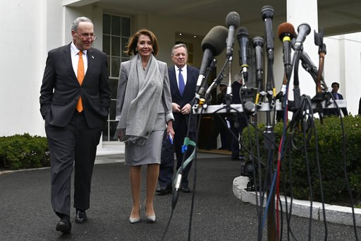 (AP Photo/Susan Walsh). House Speaker Nancy Pelosi of Calif., center, walk with Senate Minority Leader Sen. Chuck Schumer of N.Y., left, and Sen. Dick Durbin, D-Ill., right, to speak with reporters following their meeting with President Donald Trump on...