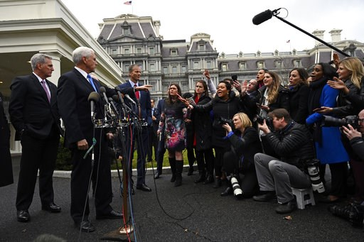 (AP Photo/Susan Walsh). Vice President Mike Pence, second from left, standing with House Minority Leader Kevin McCarthy of Calif., left, and Sen. John Thune, R-S.D., third from left, calls on a reporter following a meeting with President Donald Trump a...