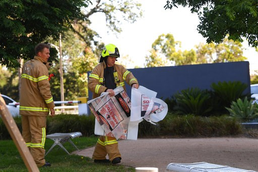 (James Ross/AAP Image via AP). A fire fighter is seen carrying a hazardous material bag into the Korean consulate in Melbourne, Wednesday, Jan. 9, 2019.  Several foreign consulates in Melbourne were evacuated Wednesday as Australian officials noted the...