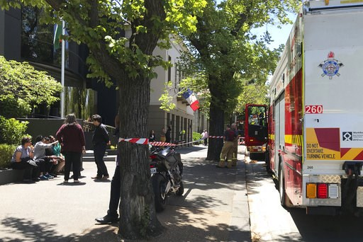 (Kaitlyn Offer/AAP Image via AP). Firefighters, right, are seen outside the Indian and French consulates on St Kilda Road in Melbourne, Wednesday, Jan. 9, 2019. Several foreign consulates in Melbourne were evacuated Wednesday as Australian officials no...