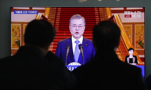 (AP Photo/Lee Jin-man). People watch a TV screen showing a live broadcast of South Korean President Moon Jae-in's New Year speech at the Seoul Railway Station in Seoul, South Korea, Thursday, Jan. 10, 2019.  President Moon has suggested he'll push for ...