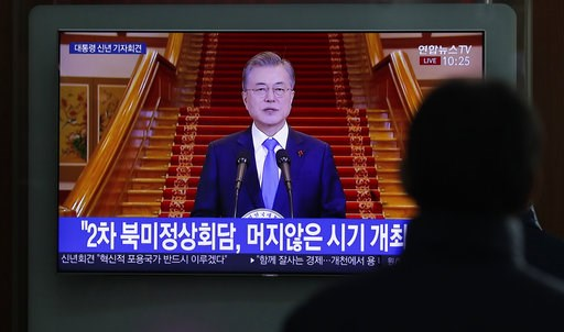 """(AP Photo/Lee Jin-man). A man watches a TV screen showing a live broadcast of South Korean President Moon Jae-in's New Year speech at the Seoul Railway Station in Seoul, South Korea, Thursday, Jan. 10, 2019. The letters read """"Second summit between Nort..."""