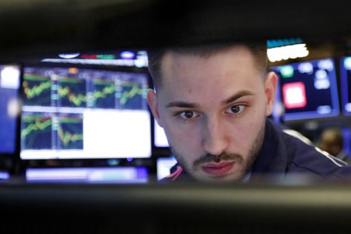 (AP Photo/Richard Drew). Specialist Matthew Greiner works at his post on the floor of the New York Stock Exchange, Wednesday, Jan. 9, 2019. Stocks are opening higher on Wall Street, putting the market on track for a fourth gain in a row.