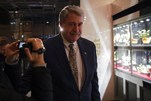 (AP Photo/Andy Wong). U.S. Undersecretary for Trade and Foreign Agricultural Affairs Ted McKinney walks into a hotel after a second day of meetings with Chinese officials in Beijing, Tuesday, Jan. 8, 2019. An official Chinese newspaper warned Washingto...