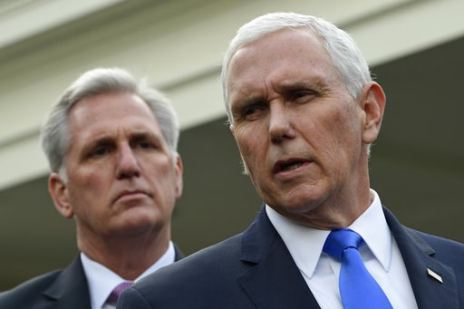 (AP Photo/Susan Walsh). Vice President Mike Pence, right, standing with House Minority Leader Kevin McCarthy of Calif., left, speaks to reporters following a meeting with President Donald Trump and Democratic congressional leaders at the White House in...