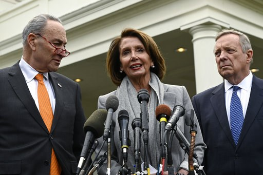 (AP Photo/Susan Walsh). House Speaker Nancy Pelosi of Calif., center, standing with Senate Minority Leader Sen. Chuck Schumer of N.Y., left, and Sen. Dick Durbin, D-Ill., right, speak with reporters following their meeting with President Donald Trump a...