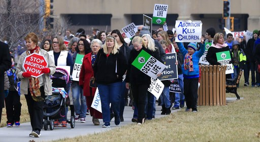 (AP Photo/Orlin Wagner, File). FILE - In this Jan. 23, 2017, file photo, marchers arrive for a Roe v. Wade protest as hundreds converge on the Kansas Statehouse to mark the 1973 Supreme Court decision that legalized abortion nationwide. Abortion oppone...