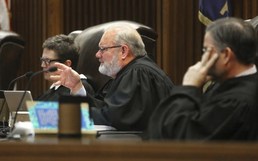 (Thad Allton/The Topeka Capital-Journal via AP, Pool). FILE - In this March 16, 2017, file photo, Kansas Supreme Court Justice Lee Johnson asks questions during oral arguments in a legal fight over a state law banning a second-trimester abortion proced...