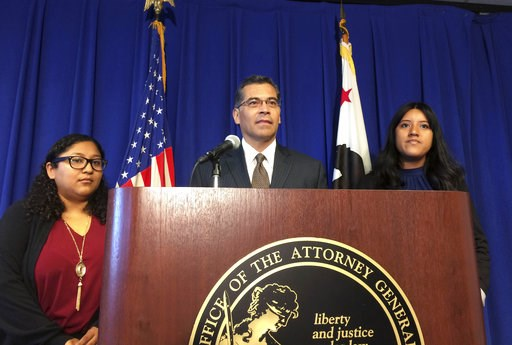(AP Photo/Don Thompson, File). FILE - In this Monday, Sept. 11, 2017, file photo, California Attorney General Xavier Becerra is flanked by Rosa Barrientos, of East Los Angeles, left, and Eva Jimenez, of Visalia, right, as he announces a lawsuit challen...