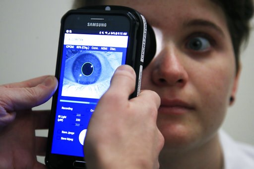 (AP Photo/Manuel Balce Ceneta). Clinical Research Assistant Kevin Jackson uses AlgometRx Platform Technology on Sarah Taylor's eyes to measure her degree of pain at the Children's National Medical Center in Washington, Monday, Dec. 10, 2018. Children's...