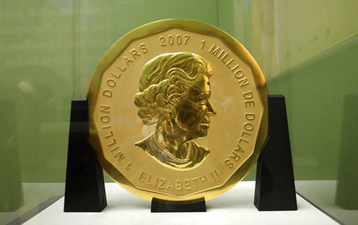 (Marcel Mettelsiefen/dpa via AP, file). FILE - The Dec. 12, 2010 file photo shows the gold coin 'Big Maple Leaf' in the Bode Museum in Berlin. Four young men have gone on trial over the brazen theft of a 100-kilogram (221-pound) Canadian gold coin from...