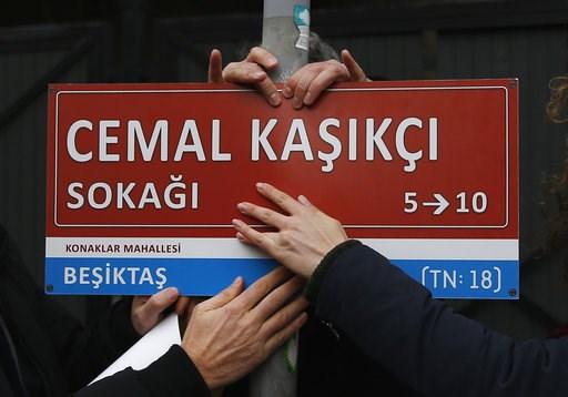 (AP Photo/Lefteris Pitarakis). Members of Amnesty International place an unofficial street sign reading in Turkish: 'Jamal Khashoggi Street', near the Saudi consulate in Istanbul, Thursday, Jan. 10, 2019, marking the 100th day since Saudi journalist Ja...