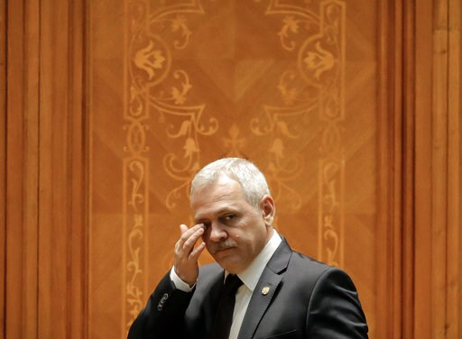 (AP Photo/Vadim Ghirda, File). FILE - In this Thursday, Dec. 20, 2018 file photo, Head of the Ruling Social Democratic Party, Liviu Dragnea, wipes his eyes as he joins a parliament session during a no-confidence vote initiated by opposition parties in ...