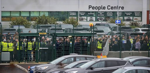 (Peter Byrne/PA via AP). Staff gather inside the gates of the Jaguar Land Rover site in Halewood near Liverpool, England, Thursday Jan. 10, 2019.  According to media reports, Jaguar Land Rover is widely expected to announce up to 5,000 job cuts as the ...