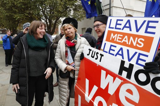 (AP Photo/Alastair Grant). British conservative lawmaker Anna Soubry, centre, who campaigned to remain in the European Union during referendum debates, reacts with pro-Brexit protesters outside parliament in London, Thursday Jan. 10, 2019. Soubry was v...